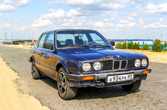 BMW E30 324d. NOVYY URENGOY, RUSSIA - JULY 13, 2013: Motor car BMW E30 324d in the city street Royalty Free Stock Photos