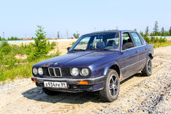BMW E30 324d. NOVYY URENGOY, RUSSIA - JULY 17, 2013: Motor car BMW E30 324d at the countryside Royalty Free Stock Images