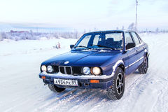 BMW E30 324d. NOVYY URENGOY, RUSSIA - MARCH 24, 2013: Motor car BMW E30 324d in the city street Royalty Free Stock Images