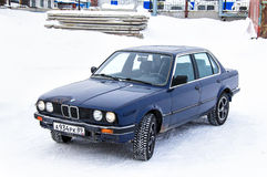 BMW E30 324d. NOVYY URENGOY, RUSSIA - MARCH 24, 2013: Motor car BMW E30 324d in the city street Stock Photos