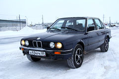 BMW E30 324d. PANGODY, RUSSIA - DECEMBER 1, 2012: Motor car BMW E30 324d at the city street Royalty Free Stock Images