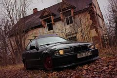 Bmw e36, 1991 , darkly. Bmw e36 1991, sedan, driftcar, autumn, in city, darkly, ring Royalty Free Stock Images