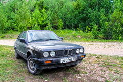 BMW E30 316i. BIKSYANOVO, RUSSIA - JUNE 10, 2012: Motor car BMW E30 316i at the countryside Stock Images