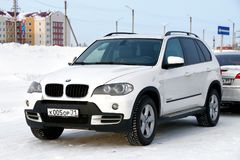 BMW E70 X5. Novyy Urengoy, Russia - March 25, 2018: Motor car BMW E70 X5 in the city street stock photography