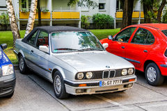 BMW E30 3-series. BERLIN, GERMANY - JULY 20, 2014: Motor car BMW E30 3-series at the city street Stock Photos