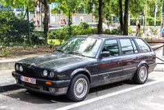 BMW E30 3-series. BRUSSELS, BELGIUM - AUGUST 9, 2014: Retro estate car BMW E30 3-series in the city street Royalty Free Stock Images