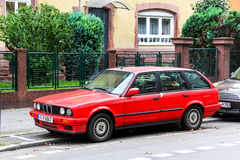 BMW E30 3-series. FRANKFURT AM MAIN, GERMANY - SEPTEMBER 15, 2013: Motor car BMW E30 3-series in the city street Royalty Free Stock Photos