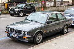 BMW E30 3-series. GENEVA, SWITZERLAND - AUGUST 4, 2014: Grey classical car BMW E30 3-series at the city street Royalty Free Stock Image