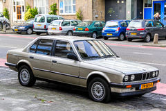BMW E30 3-series. ROTTERDAM, NETHERLANDS - AUGUST 9, 2014: Motor car BMW E30 3-series in the city street Royalty Free Stock Photo