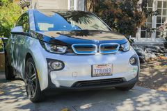 A BMW electric vehicle, model I3, parked in front of a house royalty free stock photos