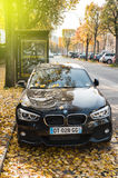 BMW executive car parked in autumn city Royalty Free Stock Image