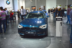 BMW first series Dark Blue Traffic Moscow International Automobile Salon Stock Photography