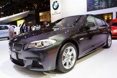 BMW 528i bil på expo för Thailand Internationalmotor Arkivfoton
