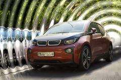 BMW i3 red car. BMW i3 red car on a blurred background royalty free stock image