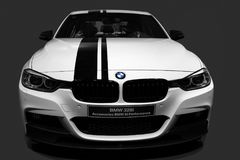BMW 328i. A white BMW 328i in the black backgroundn Royalty Free Stock Image