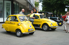 BMW Isetta 300 and Volkswagen Beetle. BERLIN - MAY 28: A small vehicle BMW Isetta 300 (ADAC) and the Volkswagen Beetle (ADAC), the exhibition 125 car history Stock Photos