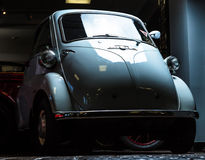BMW Isetta small retro car dark background Adler Trumpf Junior brown luxury retro car Cabrio Limousine dark background. BMW Isetta small retro car dark royalty free stock photos
