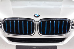 BMW logo at front grill of X5 eDrive Stock Image