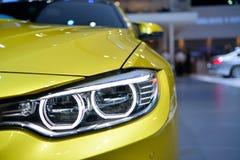 BMW M4小轿车车灯在曼谷国际泰国Moto 免版税图库摄影
