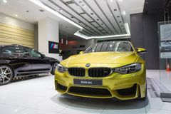 BMW M4 car for sale. BMW M4 car in showroom for sale. 2014.06 royalty free stock photos