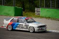 BMW M3 E30 DTM car test at Monza. This classic BMW of the Schnitzer team was originally driven by Altfrid Heger in the 1991 Deutsche Tourenwagen Masters Royalty Free Stock Images