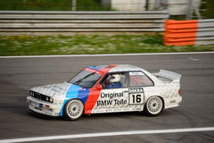 BMW M3 E30 DTM car test at Monza. This classic BMW of the Schnitzer team was originally driven by Altfrid Heger in the 1991 Deutsche Tourenwagen Masters Royalty Free Stock Photos