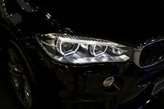 BMW X6M 2017. Headlight of a modern sport car. Front view of luxury sport car. Car exterior details. Stock Photos