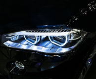 BMW X6M 2017. Headlight of a modern sport car. Front view of luxury sport car. Car exterior details. Stock Images