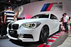 BMW M135i compact sports car on display at BMW World 2014 Royalty Free Stock Image