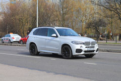 BMW X5 M. KALININGRAD, RUSSIA - APRIL 2, 2016: A new white SUV BMW X5 M on city road royalty free stock image