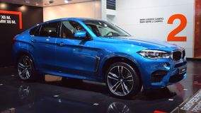 BMW X6 M luxury crossover SUV. Blue BMW X6 M luxury crossover SUV car on display during the 2015 Brussels motor show stock video