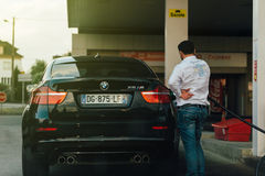 BMW X6 m refueling at gas station Stock Photos