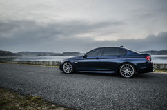 BMW m5. Sky-blue car. The strength in the simplicity and beauty. Enjoying the view Stock Photography