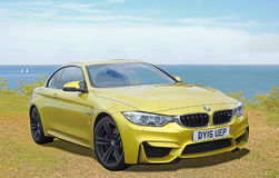 Bmw m4 sportscar. Photo of a gold bmw m4 high performance sportscar on display at the whiitstable outdoor car show 23rd july 2017 Royalty Free Stock Photo