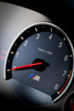 BMW M3 tachometer. Bucharest, Romania - August 4, 2013: Detail of the tachometer of a BMW M3 car. The BMW M3 is a high-performance version of the BMW 3-Series Royalty Free Stock Images