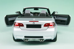 BMW M3 convertible. Sports car's back-corner view isolated on pale-green background Stock Photography