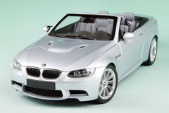 BMW M3 convertible. Sports car isolated on pale-green background Stock Photos