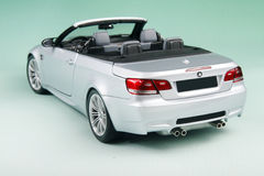 BMW M3 convertible. Sports car's back-corner view isolated on pale-green background Royalty Free Stock Image