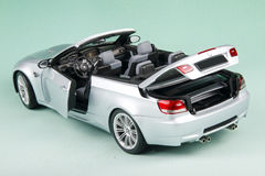 BMW M3 convertible. Sports car's back-corner view isolated on pale-green background Stock Photos