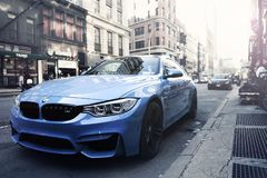 BMW M4 auto on city streets Stock Photos