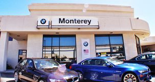 BMW of Monterey. Luxury car dealership in Monterey California with lens flare Stock Image