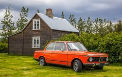 1974 BMW 2002. With an old Icelandic house in background on a antique car show in Iceland Stock Photos