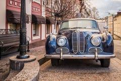 BMW 501 oldtimer car. Vintage BMW 501 oldtimer german car stands in the street Stock Photos