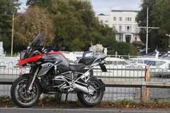 BMW R1200GS TE motorcycle at East Molesey Lock beside the river Thames in England. Side on. BMW R1200GS TE motorcycle at East Molesey Lock beside the river royalty free stock images