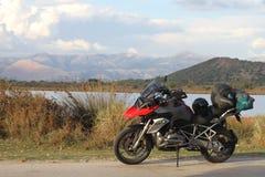 BMW R1200GS TE at Ormos Valtou near Igoumenitsa. BMW R1200GS TE at Ormos Valtou near Igoumenitsa, Greece. Profitis Ilias mountains in the background. Tall Stock Images