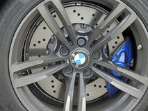 Bmw racing car alloy wheel Stock Images