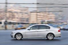 BMW S系列轿车在市中心,北京,中国 免版税库存图片
