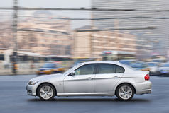 BMW s series sedan in city center, Beijing, China. BEIJING-DEC. 6. BMW 3 Series. In the first half of 2013 BMW sold 183,000 cars and SUV's in China, a 15% Royalty Free Stock Images