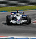 BMW Sauber F1 Team Nick Heidfeld F1.07 Germany Sep. Nick Heidfeld lifts the tyre while negotiating a turn at Sepang F1 Malaysia 2007 Grand Prix Royalty Free Stock Image