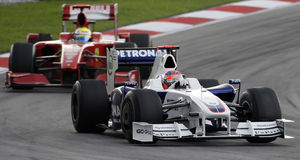 BMW Sauber F1 Team Robert Kubica 2009. Robert Kubica defending his position against Felipe Massa of Scuderia Ferrari while negotiating a turn at Sepang F1 Stock Photo